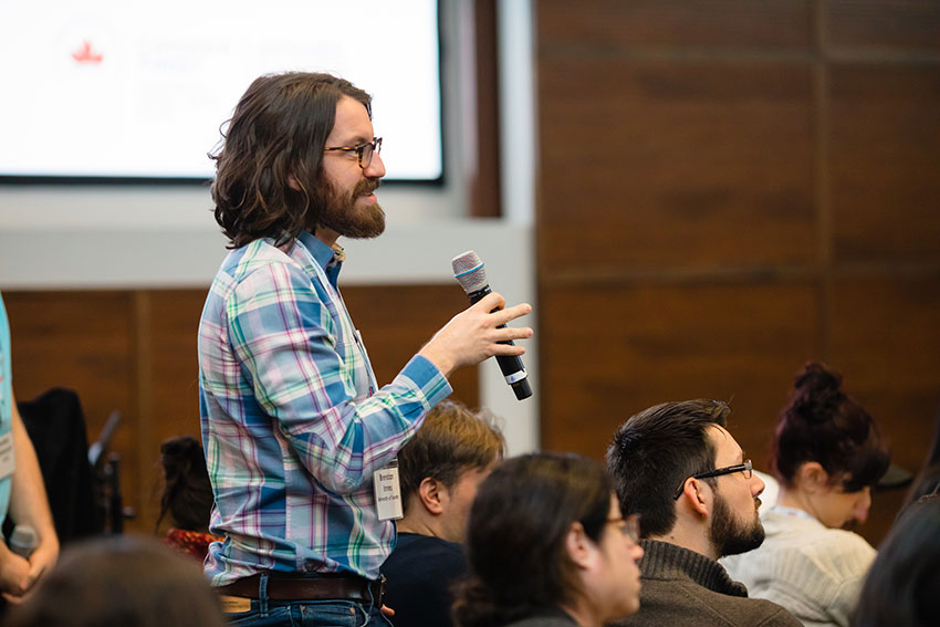 Brendan Innes, a PhD candidate in Gary Bader's lab, asks a question after a talk.