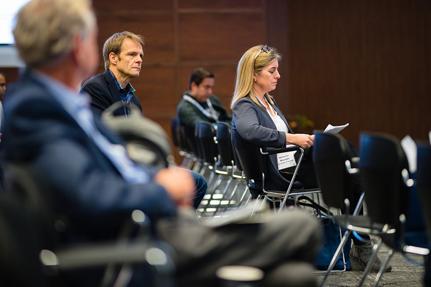 Invited speaker Lorenz Studer (left) waits to give his talk on cell and gene therapy for regenerative medicine.