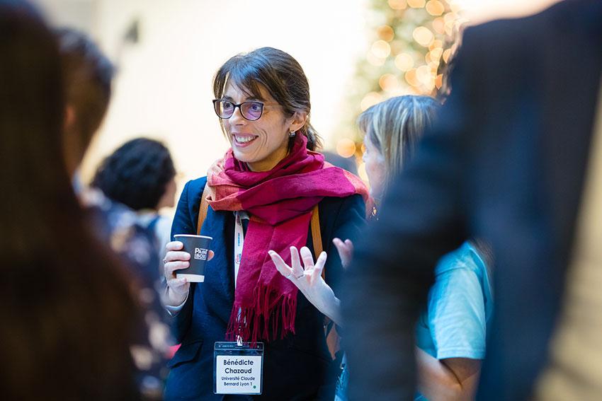 Invited speaker Bénédicte Chazaud (Université Claude Bernard Lyon 1) talks with symposium attendees during a break.