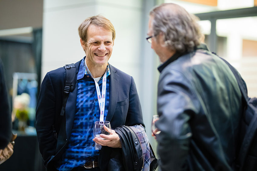 Lorenz Studer (left), a keynote speaker from Memorial Sloan Kettering Cancer Center in New York, talks with Andras Nagy, a principal investigator at Sinai Health System.