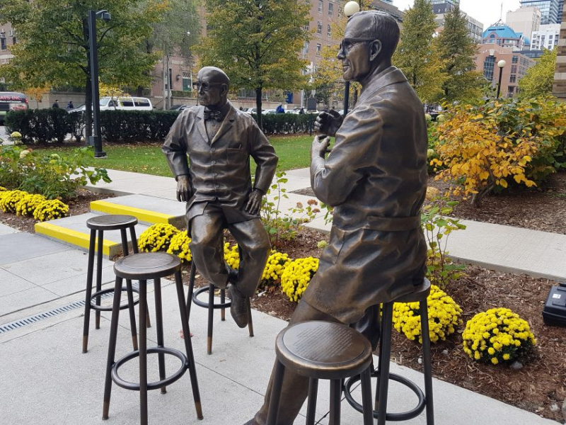 Photo of statues of Ernest McCulloch and James Till outside the MaRS Centre in Toronto.