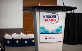 Medicine by Design symposium podium