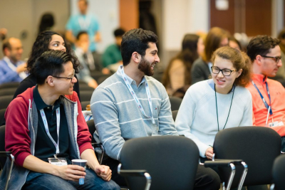Trainees chat at a Medicine by Design event